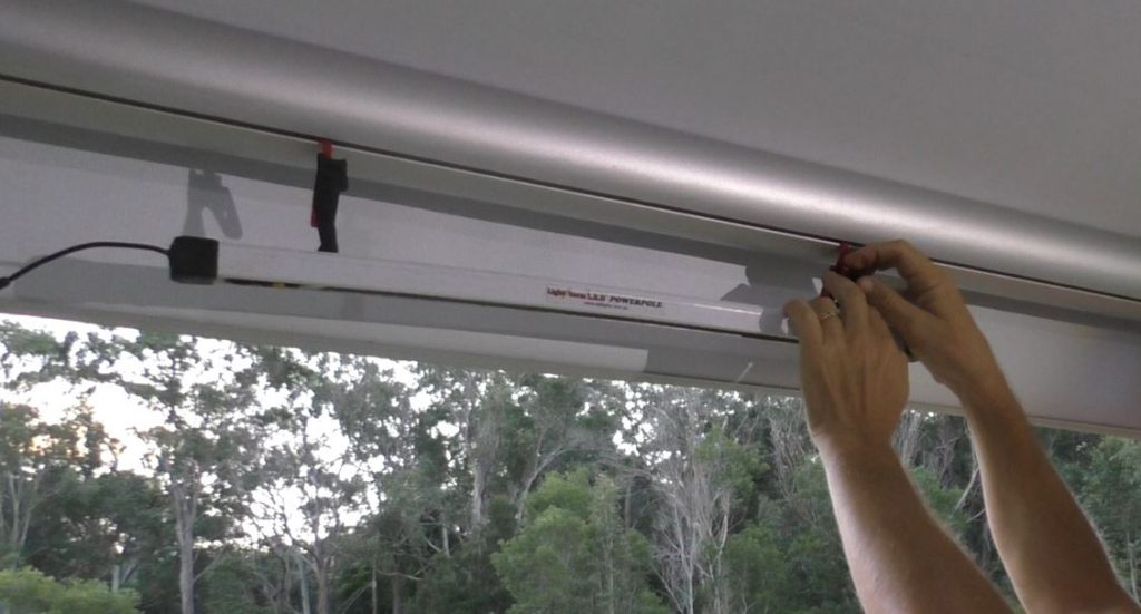 Hang an LED light off the awning hooks of your Caravan or RV